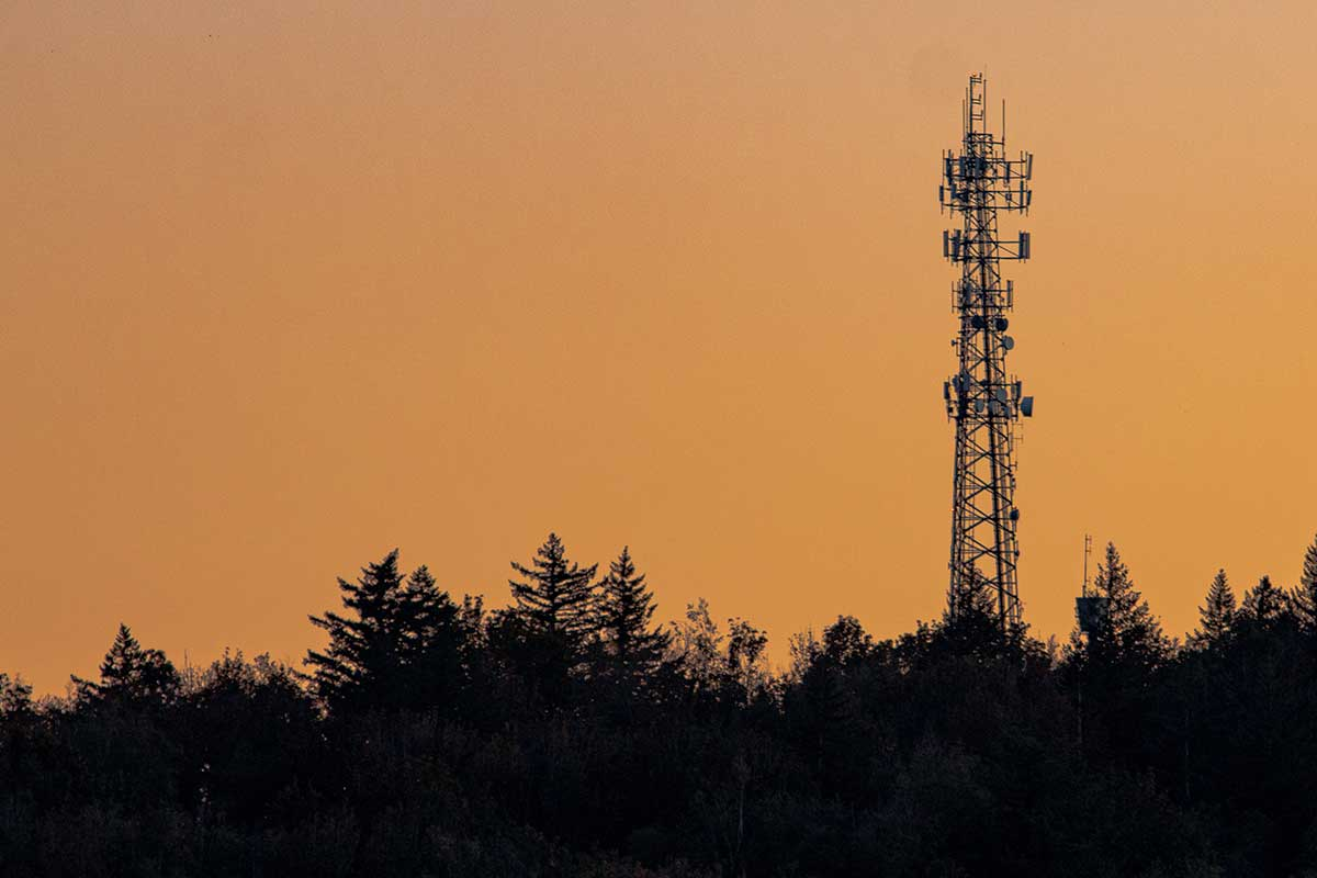 Cellular tower in front of an evening sky