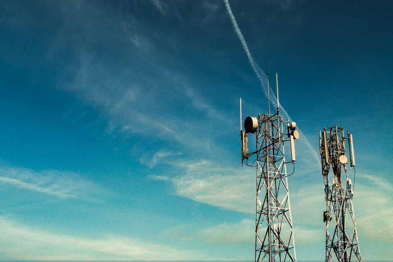 Cellular towers with blue sky behind