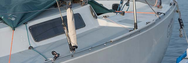 boat docked with weather protection covering overtop